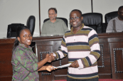 RMU student Ama Amuah Sam (left) receives certificate of participation from Joseph Ansong (right)