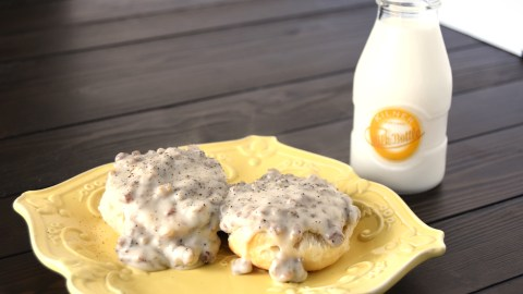Biscuits and Sausage Gravy on yellow plate