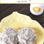 biscuits with sausage gravy on yellow plate
