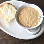 Potato soup in bowl with bread