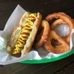 Hot dog and onion rings in basket