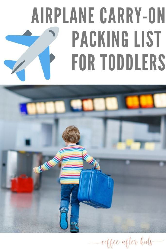 Toddler in airport with carry on bag