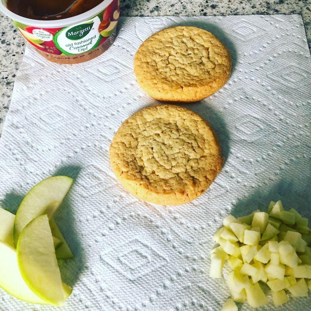 Caramel apple dessert pizzas ingredients: caramel dip, apple slices, sugar cookies, and apple chunks