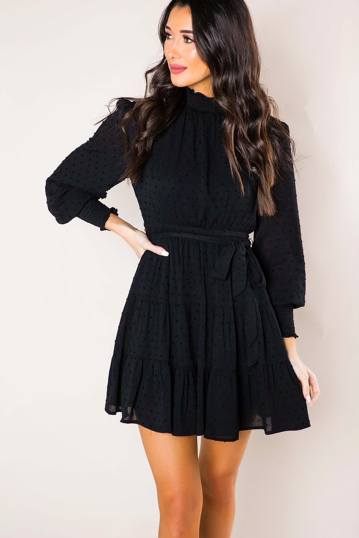 girl with black long sleeve dress from a boutique