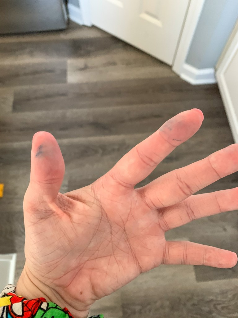 colored dye on hands