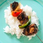 Teriyaki Marinated steak on kabobs over rice