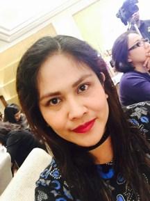 Wearing L'Oreal lipstick