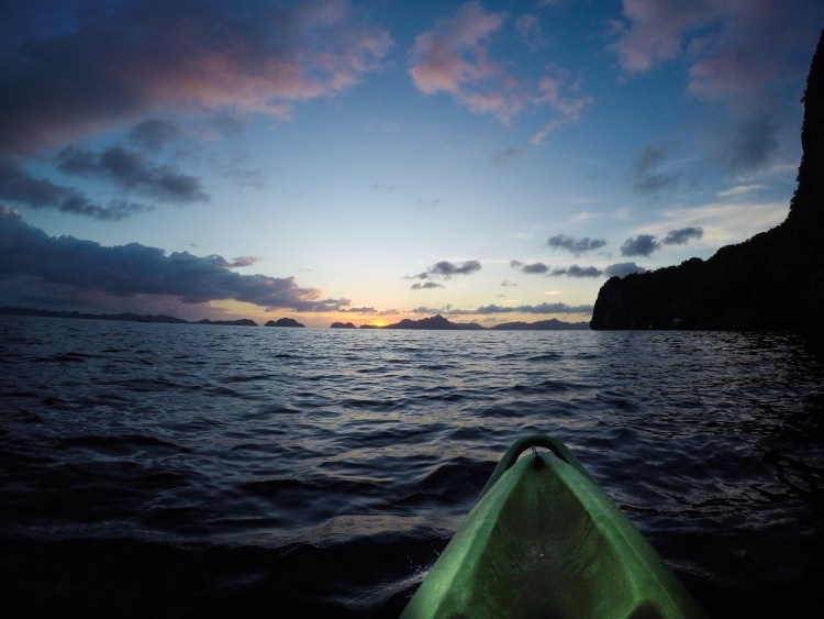 Kayaking at sunset, Corong Corung beach, El Nido district, Philippines