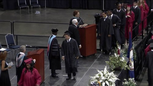 Crossing the stage to get his diploma