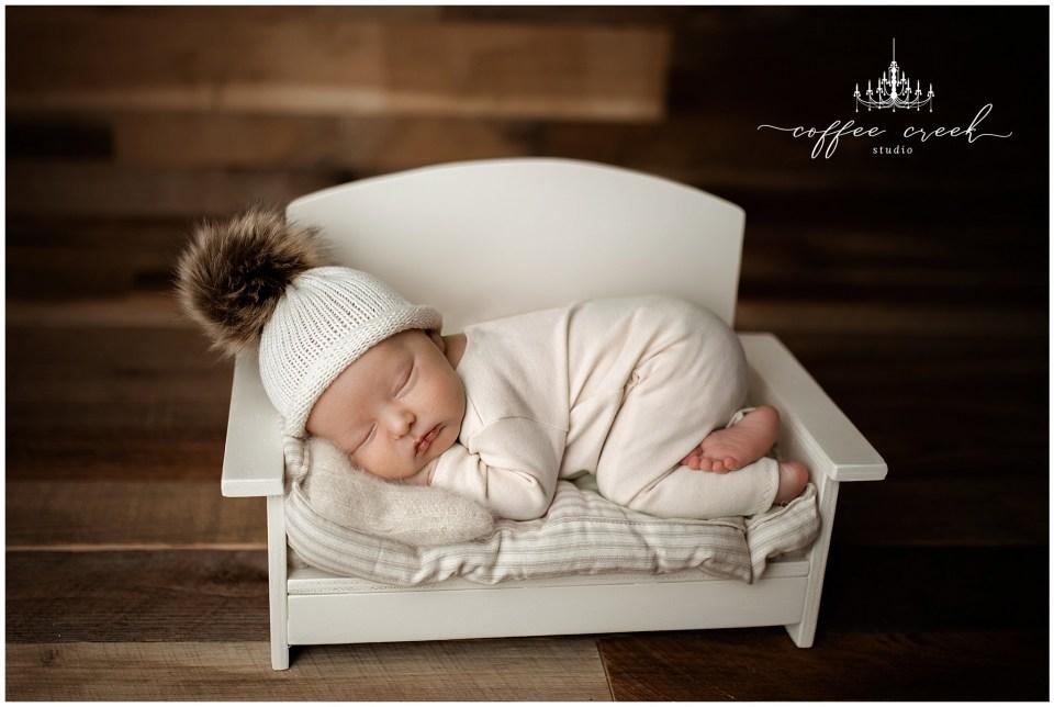 newborn baby on couch