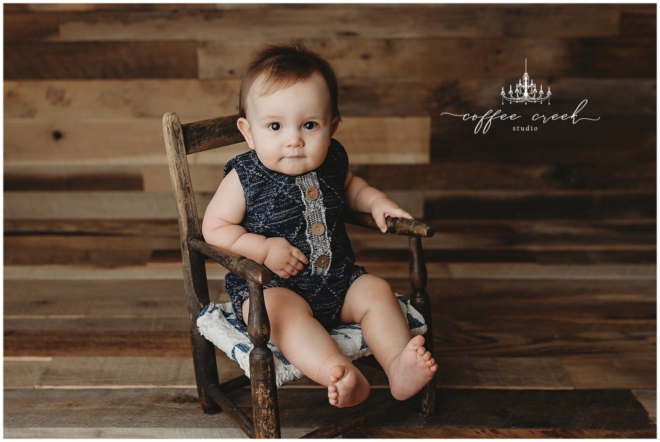 one year old in rocking chair
