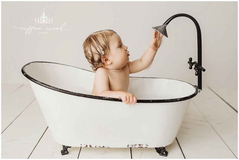 one year old session baby boy in bathtub