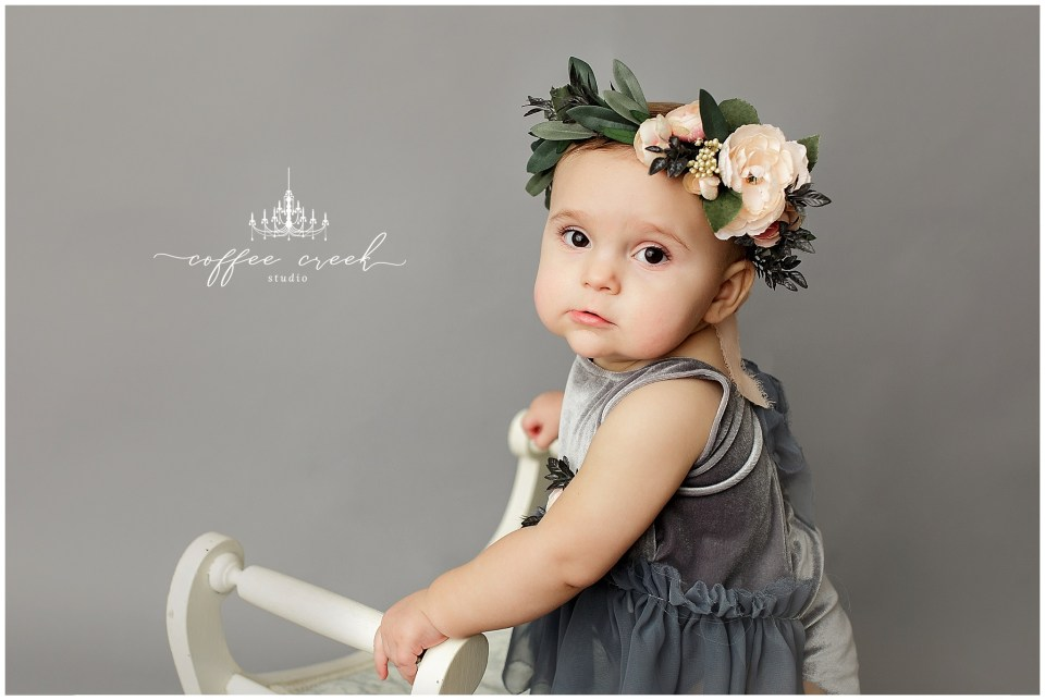 one year old on grey with flower crown