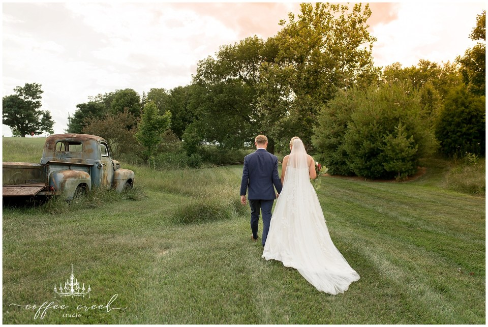 bride and groom sunset at barn venue wedding
