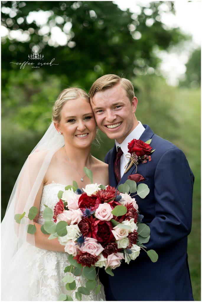 bride and groom portrait at barn venue wedding