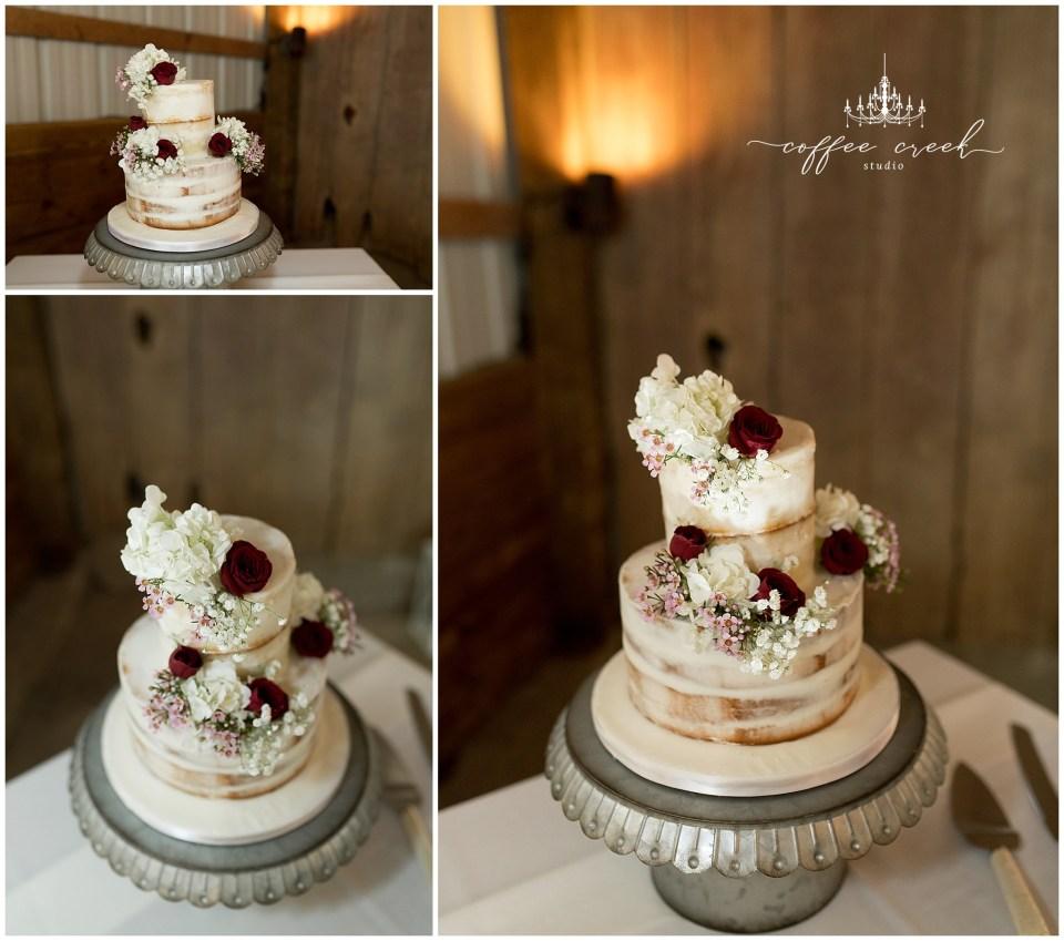 wedding cake at barn venue wedding reception