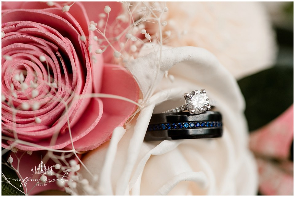 bride and groom wedding rings in bouquet
