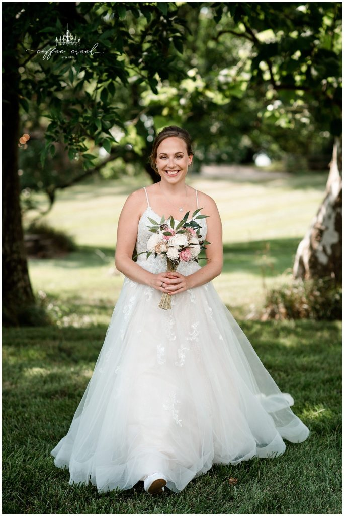 bride in wedding dress with flowers