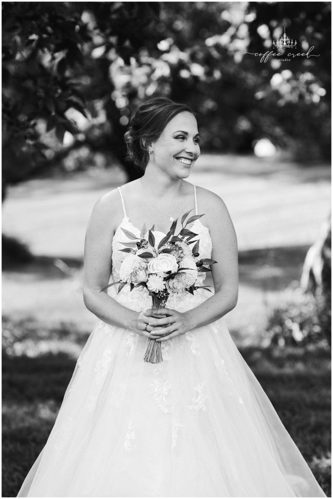 bride with flowers smiling