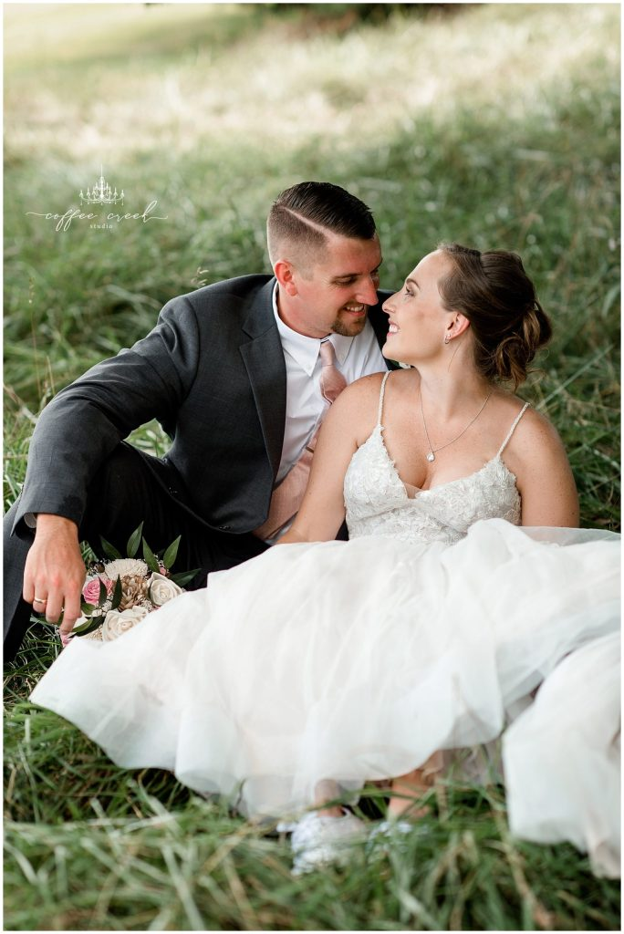bride and groom in grass