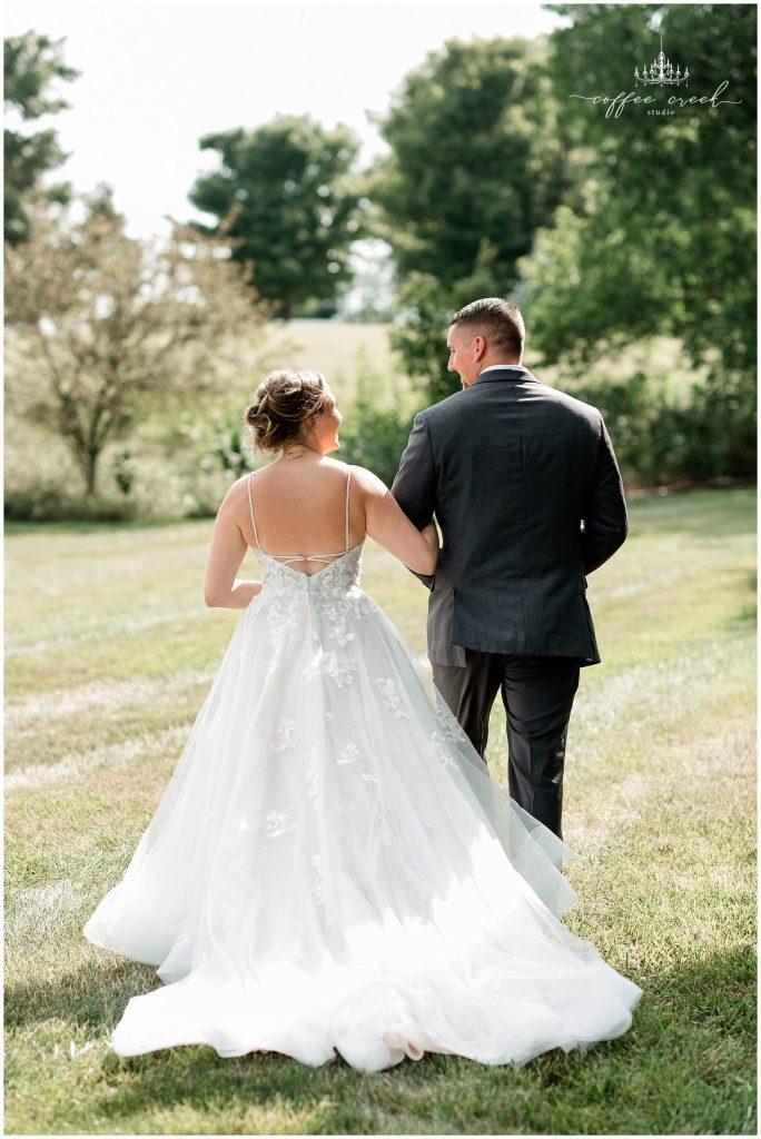 bride and groom at barn venue wedding reception