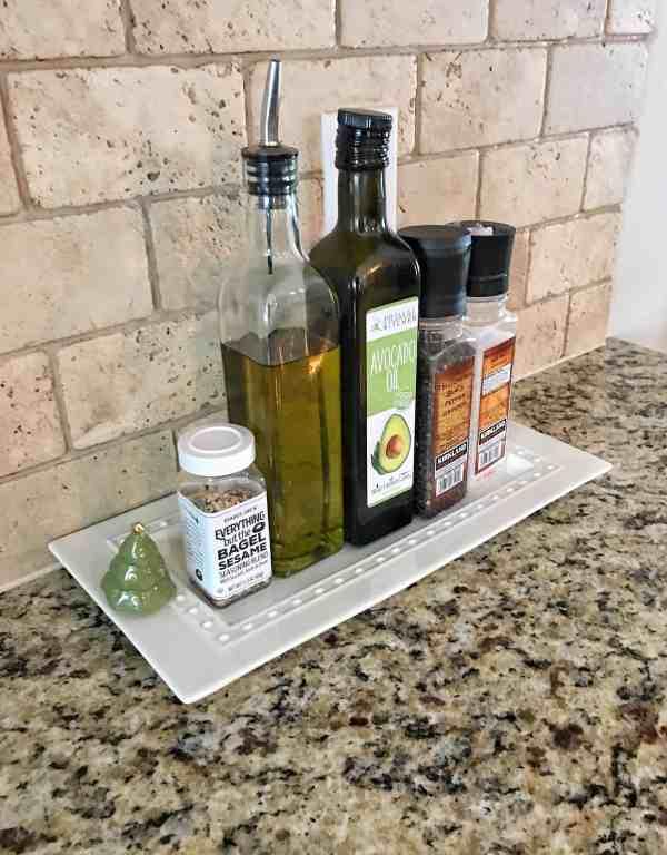 Organize spices and oils on a tray for a farmhouse kitchen element #farmhousedecor #farmhousekitchen #kitchenorganization