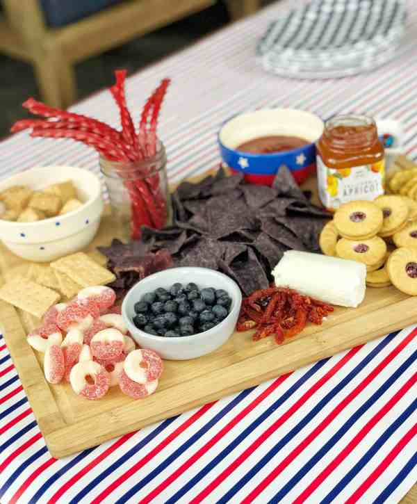Red White and Blue themed snack platter for summer entertaining #charcuterieboard #snacktray #fingerfood #appetizers #4thofjuly