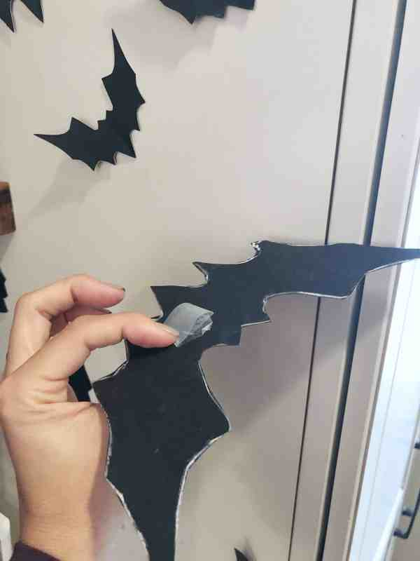 How to adhere flying wall bats for Halloween