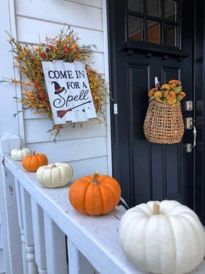 Mini pumpkins on front porch