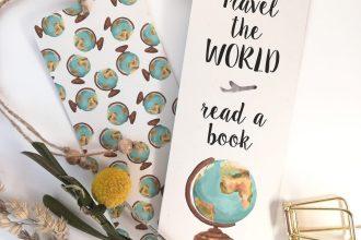 Lesezeichen mit Zitat und Globus Illustration