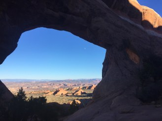 Sneak a view of the Utah desert through Partition Arch.