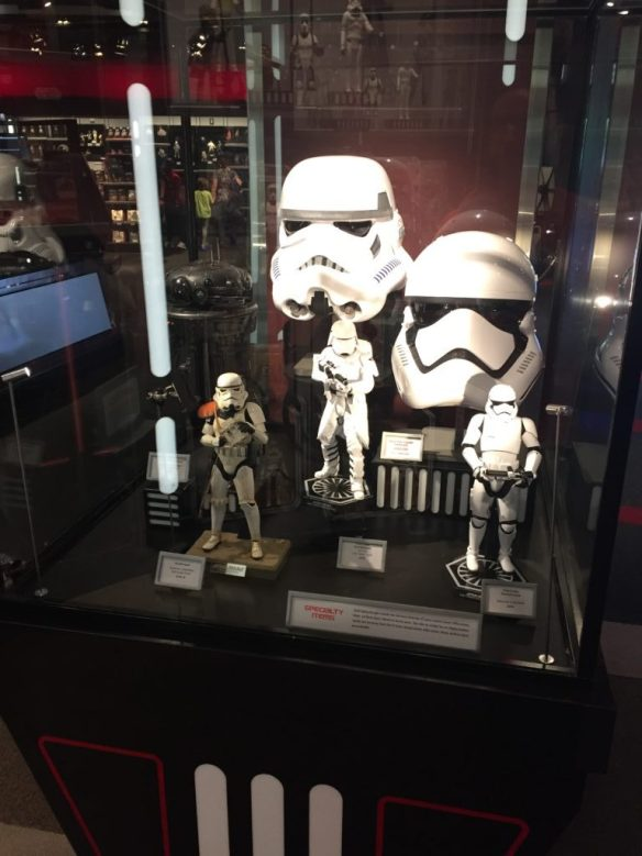 Replica helmets and statues available for purchase.