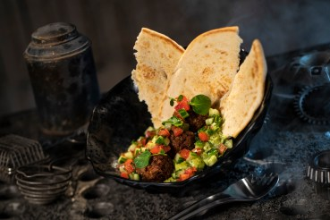 Innovative and creative eats from around the galaxy will be available at Star Wars: Galaxy's Edge when it opens May 31, 2019, at Disneyland Park in Anaheim, Calif., and Aug. 29, 2019, at Disney's Hollywood Studios in Lake Buena Vista, Fla. The Felucian Garden Spread, found at Docking Bay 7 Food and Cargo inside Star Wars: Galaxy's Edge, is a plant-based kefta meatball dish with herb hummus and tomato-cucumber relish with pita bread. (David Roark/Disney Parks)