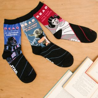 OUT OF PRINT - Star Wars Reads Socks - $12 For the partner who loves to read - Our Star Wars socks are inspired by the vintage READ® posters by the American Library Association inspiring kids to read during the 80s and 90s. Shop now at Out of Print: https://outofprint.com/collections/star-wars