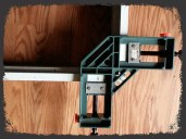 Using a corner clamp to hold the door casing together after cutting it down to the proper dimensions