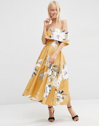 http://www.asos.com/asos/asos-premium-off-the-shoulder-bardot-midi-prom-dress-in-mustard-floral/prd/6601209?iid=6601209&clr=Mustard&SearchQuery=mustard&pgesize=33&pge=0&totalstyles=33&gridsize=3&gridrow=6&gridcolumn=1