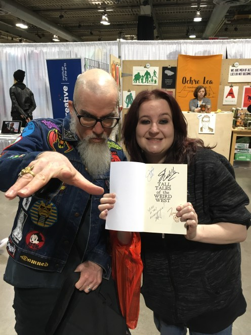 Cover artist Tom Bagley signing for a fan - Calgary Expo 2018