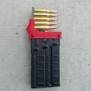 Red CETME G3 magazine clip loader