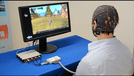 a person wired up on the head looking at a computer screen