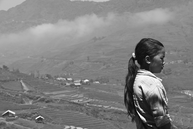 A Vietnamese woman looks over the terraces of Tavan and Sapa in northern Vietnam, site of a Chinese invasion in 1979. Source: Trilli bagus' flickr photostream, used under a creative commons license.