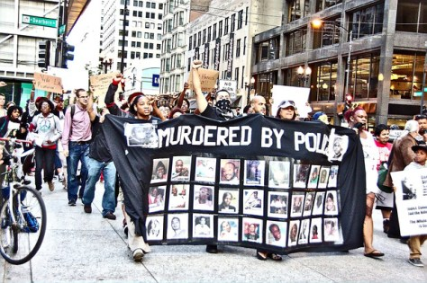 The killing of Michael Brown in Missouri last weekend prompted this Chicago protest against police violence. Photo by Mikasi.