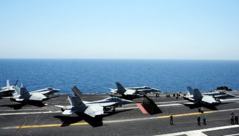 The aircraft carrier George H.W. Bush, in the Arabian Gulf on Friday, has been assigned to support the mission in Iraq. Credit Joshua Card/U.S. Navy, via European Pressphoto Agency