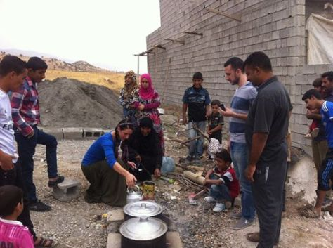 Kali making tea in Iraq with displaced persons.