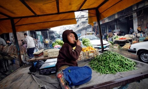 A Palestinian boy waits for customers at a market in Gaza City. Youth unemployment is set to reach 60% in the enclave. Photo by Warrick Page/Getty Images