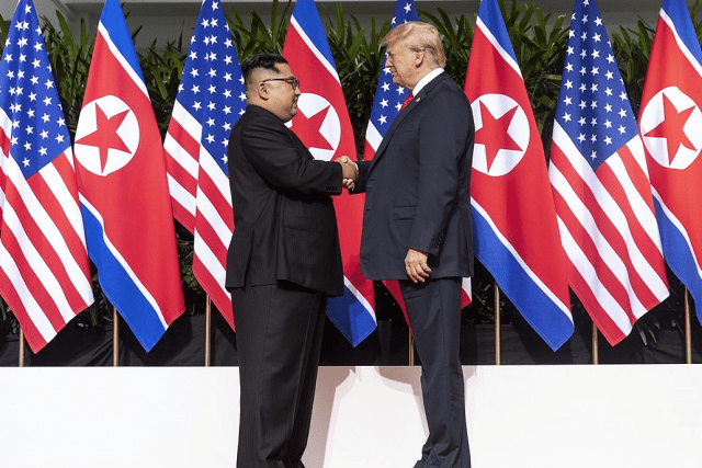 U.S. President Donald Trump and North Korea's Kim Jong Un shake hands during summit.