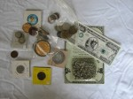 Some of the numismatic items found on my desk.