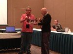 AINA President Mel Wacks (R) presents an Award of Appreciation to David Hendin for his talk at the AINA Annual Meeting