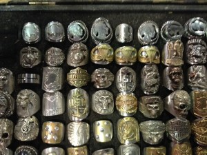 The rings from another artists features designs using coins (see top row)
