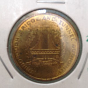 Obverse of the Triborough Bridge and Tunnel Authority Rockaways resident token.