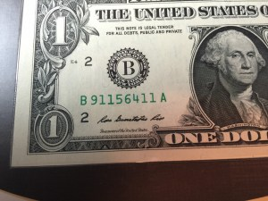 """Close up of the Series 2013 $1 FRN. Note that the serial number begins with """"911"""""""